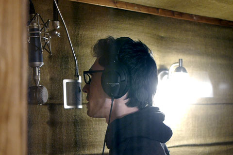 Dominick John laying down a track in the vocal booth.